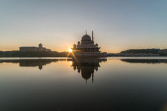 Sunrise with sunburst sunstar behind silhouette mosque Royalty Free Stock Photography