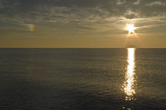 Sunrise and sundog at the end of the lake Royalty Free Stock Images