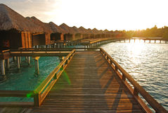 Sunrise with sunlight falling on the overwater villa Stock Image