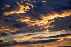 Sunrise / sunset with clouds in dark sky Stock Photo