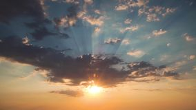 Sunrise or sunset with fluffy clouds and light rays in sky, video stock video
