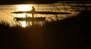 Sunrise or sunset kayak fishing Stock Images
