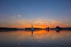 Sunrise / sunset at a lake Royalty Free Stock Photos