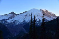 Sunrise at Sunset: Mount Rainier Head Shot. Tahoma. Mount Rainier in the Cascade Mountains of Washington State, Pacific Northwest. Volcano, Glacier. White stock image