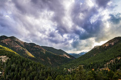 Sunrise Sunset on North Cheyenne Canyon Colorado Springs. Colorado mountain landscape at sunrise sunset in the spring summer under a blue sky. green pine forest Royalty Free Stock Photos