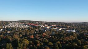 Beautiful sunrise over a Johannesburg suburb stock footage