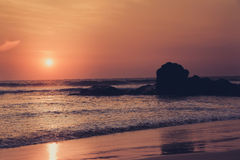 Sunrise or sunset over the ocean. Toned image Royalty Free Stock Photography