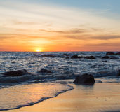 Sunrise or Sunset over the sea view from tropical beach with orange sky Stock Images