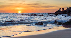 Sunrise or Sunset over the sea view from tropical beach with orange sky Stock Photography