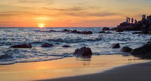 Sunrise or Sunset over the sea view from tropical beach with orange sky Royalty Free Stock Photo