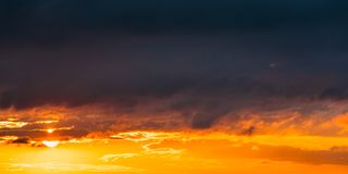 Sunrise Sunset Sunrise Sky. Bright Dramatic Sky With Clouds. Yellow royalty free stock image