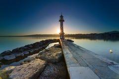 Sunrise Sunstar on Lake Geneva at Paquis Lighthouse, Geneva, Switzerland Stock Images