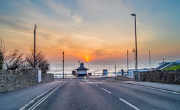 A very colourful Sunrise at the end of the road at Swanage Bay Stock Photos