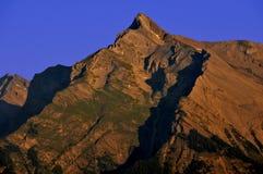 Sunrise on a swiss peak Stock Images