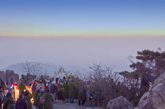 Sunrise on Taishan. Crowds of people watching the sunrise on Mount Tai in Shandong province in the winter in China stock photo