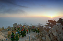 Sunrise on Taishan. Crowds of people watching the sunrise on Mount Tai in Shandong province in the winter in China stock photography