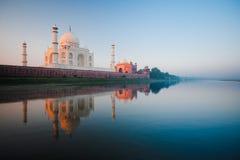 Sunrise at Taj Mahal on Jamuna river stock photos