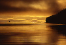 Sunrise at Telegraph cove. With fishing trawler. Vancouver Island B.C Royalty Free Stock Image