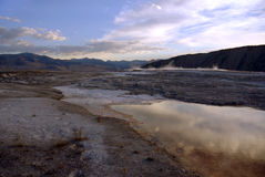 Sunrise Terrace. Stream of water from Mammoth Hot Springs upper terrace at sunrise - Yellowstone National Park, Wyoming stock image