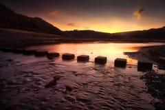 Sunrise at Three Cliffs Bay Royalty Free Stock Photos