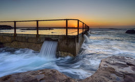 Sunrise at Tidal pool in North curl curl. Sydney, Australia Royalty Free Stock Image