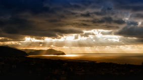 Sunrise in Tigullio Gulf. Sun rays pass through the clouds in the Gulf of Tigullio - Sestri Levante Royalty Free Stock Photography