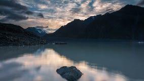 Sunrise Time Lapse at Tasman Lake, Mount Cook, New Zealand stock video footage