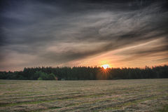 Sunrise time in summer morning , meadow with cut grass,forest  a Stock Image