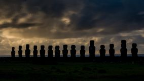 Sunrise timelapse with Ahu Tongariki silhouettes in Rapa Nui. Sunrise timelapse with Ahu Tongariki Moai silhouettes in Easter Island stock footage