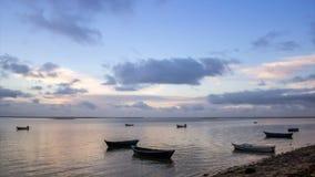 Sunrise timelapse & boat silhouette at Olhão. Algarve, southern Portugal. stock video