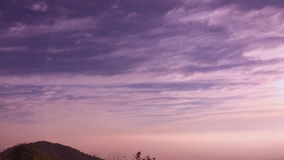 Sunrise timelapse of mountain heights with dense layer of fog stock video footage