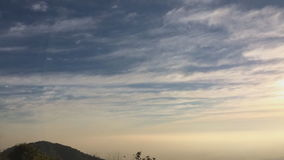 Sunrise timelapse of mountain heights with dense layer of fog stock video