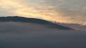 Sunrise timelapse in mountains with colourful mist. At morning stock footage