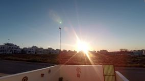 Sunrise timelapse in Spain. Sunrise timelapse over the rooftops in a clear blue sky in Spain, to start another fine day stock footage