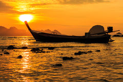 Sunrise at tip of boat Royalty Free Stock Photos
