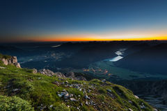 Sunrise on the top of mountain with glowing horizon Stock Image