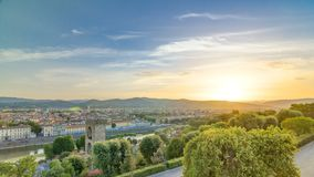 Sunrise top view of Florence city timelapse with arno river bridges and historical buildings. Mountains on background. Green trees at summer day stock footage