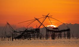 Sunrise with traditional fishing trap in Pak Pra village, Phatthalung, Thailand. Sunrise with traditional fishing trap in Pak Pra village, Phatthalung, South of stock images