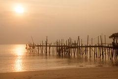 Sunrise at traditional wooden bridge on the beach. Royalty Free Stock Photography