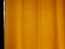 Sunrise through transparent curtains of a window. In the morning Royalty Free Stock Photos