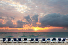 Sunrise on tropical beach. Resort,beach beds waiting for early bird tourists royalty free stock photos