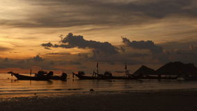 Sunrise on a tropical beach. silhouettes of boats and people, sand and sea. Sunrise on a tropical beach. silhouettes of boats and people, sand and sea, sand and stock video
