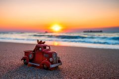 Sunrise on tropical island beach and car truck miniature.  Royalty Free Stock Photography