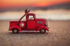Sunrise on tropical island beach and car truck miniature.  Stock Photography