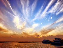 Sunrise on a tropical island in the Indian Ocean. Maldives. Royalty Free Stock Photos
