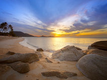 Sunrise at tropical rocky coast Royalty Free Stock Image