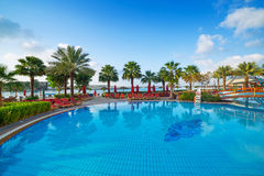 Sunrise at the tropical swimming pool. In Abu Dhabi Royalty Free Stock Photos