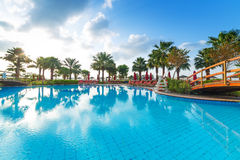 Sunrise at the tropical swimming pool. In Abu Dhabi Stock Photo