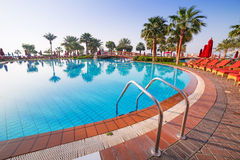 Sunrise at the tropical swimming pool. In Abu Dhabi Royalty Free Stock Images