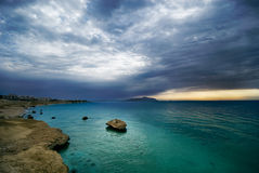 Sunrise and turquoise ocean Stock Photos